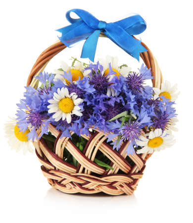 Beautiful bouquet of cornflowers and chamomiles in basket, isolated on white Stock Photo - 21898405