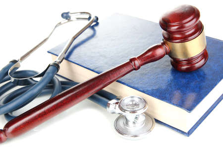 Medicine law concept. Gavel and stethoscope on book close up Reklamní fotografie