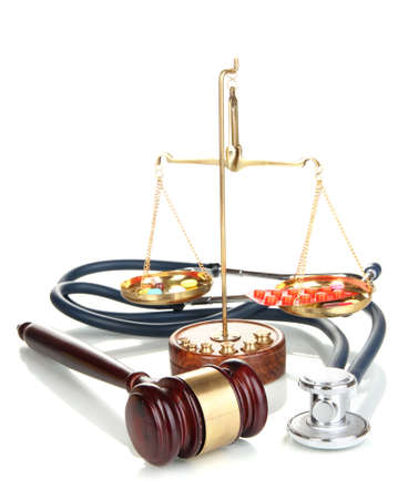 malpractice: Medicine law concept. Gavel, scales and stethoscope isolated on white