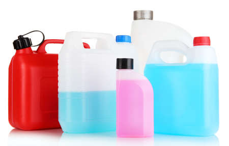 Different liquids for car in canisters isolated on white photo