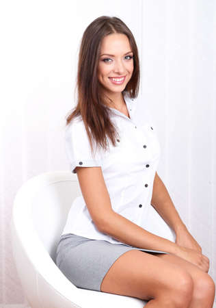 Young beautiful business woman in office photo
