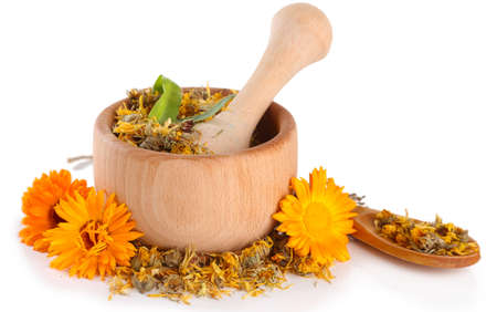 Fresh and dried calendula flowers in wooden mortar  isolated on white Stock Photo - 21977112