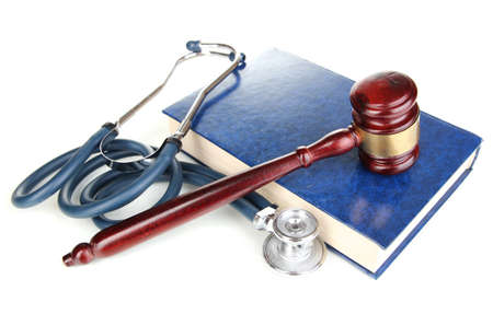 Medicine law concept. Gavel and stethoscope on book isolated on white
