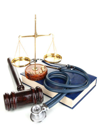 mallet: Medicine law concept. Gavel, scales and stethoscope on book isolated on white