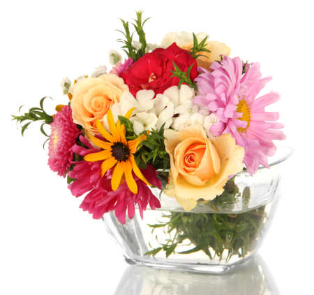 Beautiful bouquet of bright flowers in glass vase, isolated on white photo