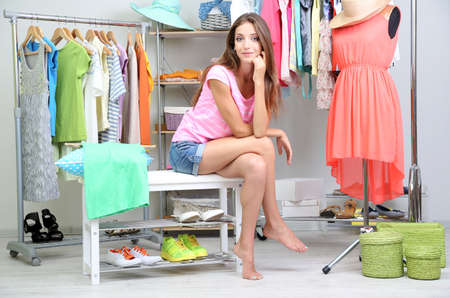 blouses: Beautiful girl thinking what to dress in walk-in closet