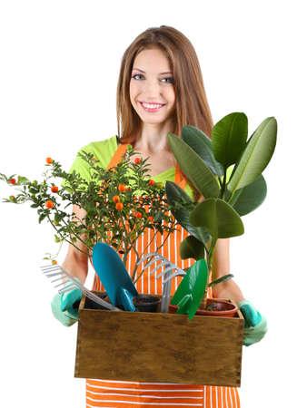 Beautiful girl gardener with flowers isolated on white Stock Photo - 22370315