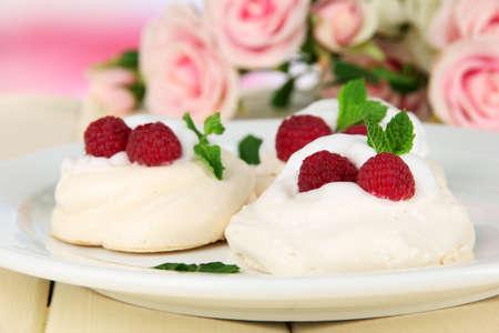 Tasty meringues cakes with berries on table Stock fotó