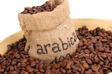 robusta: Coffee beans in bag and bowl close-up