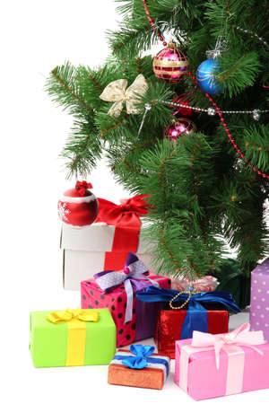 toygift: Decorated Christmas tree with gifts isolated on white Stock Photo