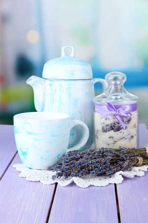 Jar of lavender sugar and fresh lavender flowers on bright background photo