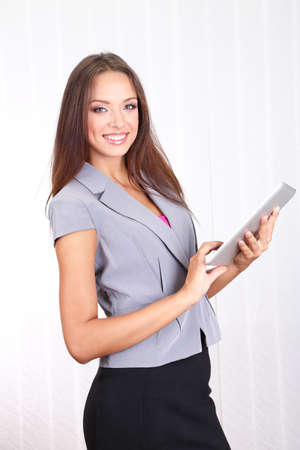 careerists: Young beautiful business woman with tablet in office Stock Photo