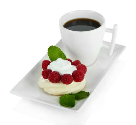 Tasty meringue cake with berries and cup of coffee, isolated on white photo