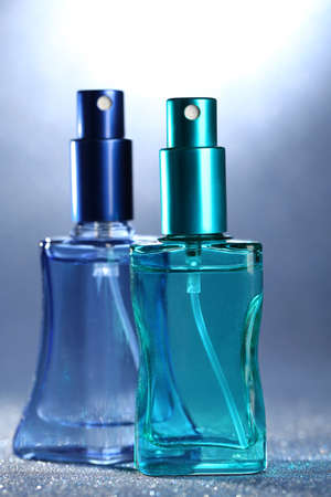 Women perfume in beautiful bottles on bright background Stock Photo