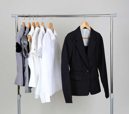 Office clothes on hangers, on gray background photo