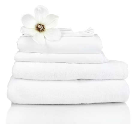 Stack of clean bedding sheets isolated on white Stock Photo