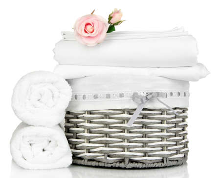 clean room: Bedding sheets in wicker basket isolated on white