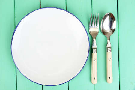 Plate and cutlery on wooden table close-up Stock Photo - 22332946