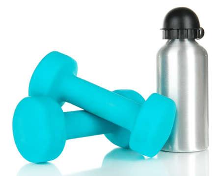 Sports bottle and dumbbells isolated on white photo