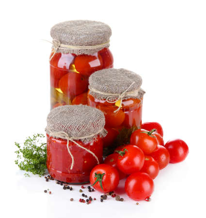 sterilized: Tasty canned and fresh tomatoes, isolated on white