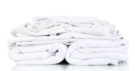 Stack of rumpled bedding sheets isolated on white Stock Photo - 22341951