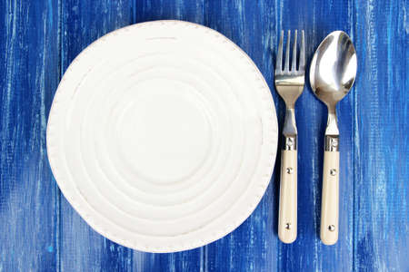 Plate and cutlery on wooden table close-up Stock Photo - 22342005