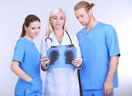 Medical workers on grey background photo