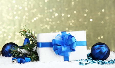 Beautiful bright gift and christmas decor, on shiny background photo