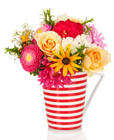 mixed flower bouquet: Beautiful bouquet of bright flowers in color mug, isolated on white Stock Photo