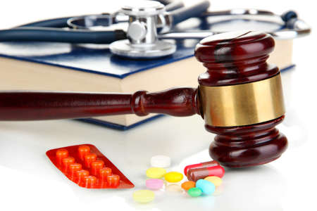 Medicine law concept. Gavel and pills close up photo
