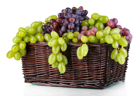 Ripe green and purple grapes in basket isolated on white Stock Photo - 22463360