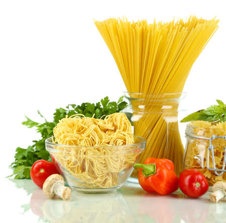 Different types pasta with vegetables isolated on white photo