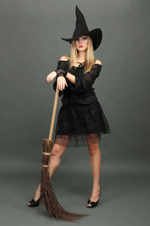 Halloween witch with  broom
