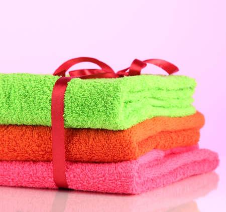 orange washcloth: Towels tied with ribbon  Stock Photo