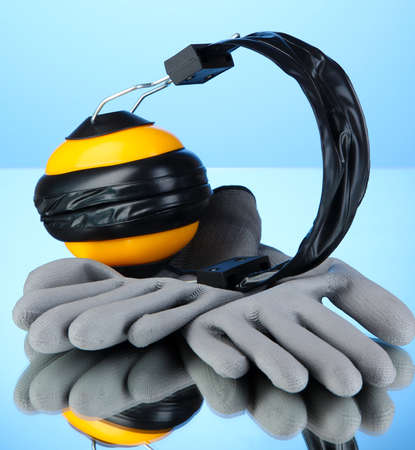 onslaught: Protective gloves and headphones  Stock Photo