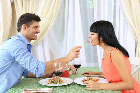woman in love: Beautiful couple having  romantic dinner at restaurant Stock Photo