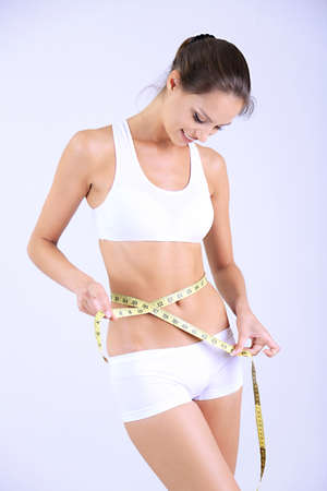 Slim girl with centimeter