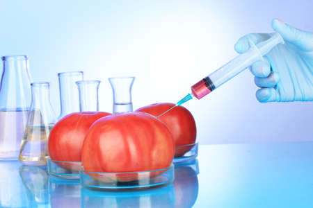 toxin: Injection into fresh red tomato