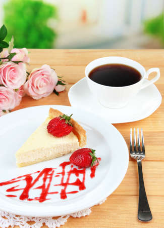 Slice of cheesecake with strawberry on plate photo