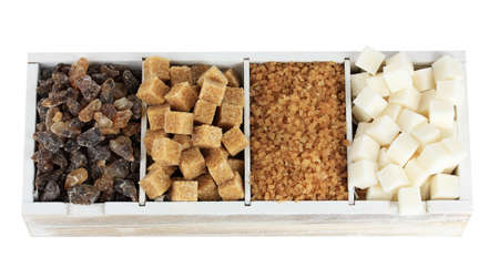 granulated: Different types of sugar in wooden box isolated on white