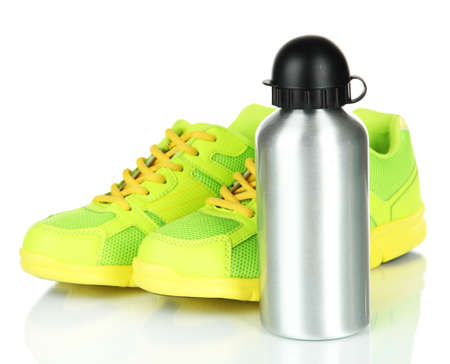 water shoes: Sports bottle and sneakers isolated on white