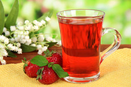 Delicious strawberry tea on table  photo