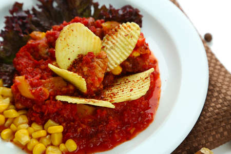 Chili Corn Carne - traditional mexican food, on white plate, on napkin, isolated on white photo
