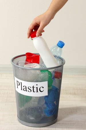 Assorted trash in bucket on room  photo