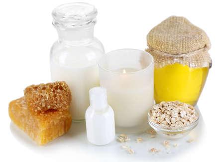 humidify: Honey and milk spa with oils and honey isolated on white Stock Photo