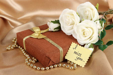 Romantic parcel on gold cloth background photo