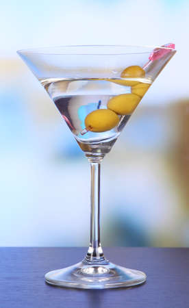Martini with green olives on table in bar Stock Photo - 22619946