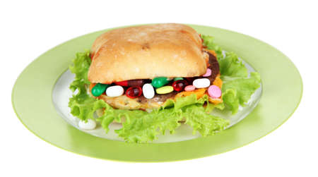Conceptual image for nutritional care:assorted vitamins and nutritional supplements in bun.Isolated on white photo