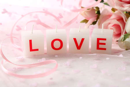 Candles with printed sign I LOVE YOU,on light background photo