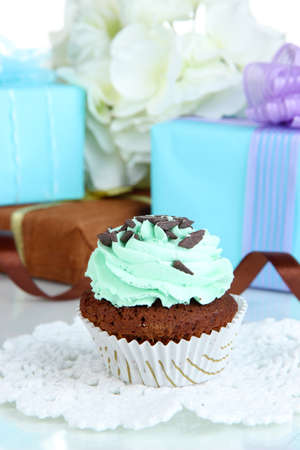 gumpaste: Tasty cupcake with gifts close up